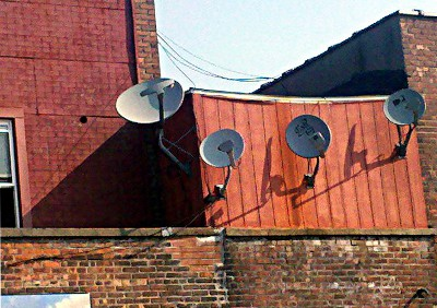 Side of a building with 4 satellite dishes